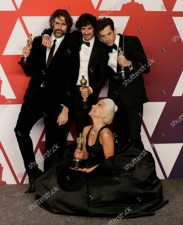 """(L-R) Andrew Wyatt, Anthony Rossomando, Mark Ronson and Lady Gaga, winners of Best Original Song for """"Shallow"""" from """"A Star is Born,"""" appear backstage with their Oscar during the 91st annual Academy Awards at Loews Hollywood Hotel in the Hollywood section of Los Angeles on February 24, 2019."""