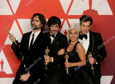 """(L-R) Andrew Wyatt, Anthony Rossomando, Lady Gaga and Mark Ronson, winners of Best Original Song for """"Shallow"""" from """"A Star is Born,"""" appear backstage with their Oscar during the 91st annual Academy Awards at Loews Hollywood Hotel in the Hollywood section of Los Angeles on February 24, 2019."""