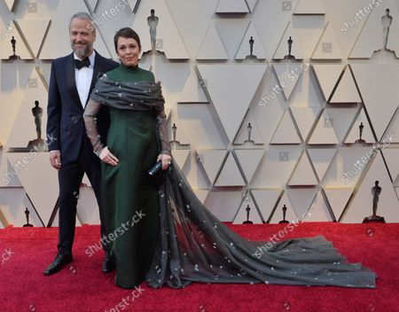 Stock Photo of Ed Sinclair and Olivia Colman arrive on the red carpet for the 91st annual Academy Awards at the Dolby Theatre in the Hollywood section of Los Angeles on February 24, 2019.