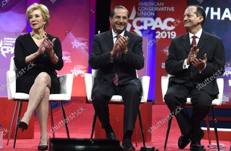 (L-R) Small Business Administration (SBA) Administrator Linda McMahon, Health and Human Services (HHS) Alex Azar and Labor Secretary Alex Acosta applaud remarks at the Conservative Political Action Conference (CPAC), February 28, 2019, in National Harbor, Maryland. Thousands of conservative activists, Republicans and Tea Party Patriots gathered to hear politicians and radio and TV hosts speak, lobby and network for the conservative cause.