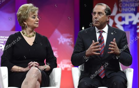Health and Human Services (HHS) Secretary Alex Azar (R) makes remarks as Small Business Administration (SBA) Administrator Linda McMahon listens at the Conservative Political Action Conference (CPAC), February 28, 2019, in National Harbor, Maryland. Thousands of conservative activists, Republicans and Tea Party Patriots gathered to hear politicians and radio and TV hosts speak, lobby and network for the conservative cause.