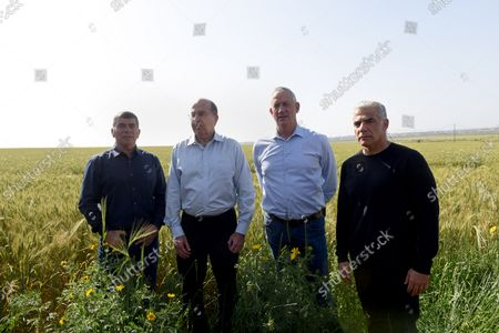 Stock Photo of L-R: Gabi Ashkenazi, Moshe Ya'alon, Benny Gantz, and Yair Lapid, the top four of the new Israeli Blue and White Party visits a wheat field in Kfar Aza on the Israeli-Gaza border in southern Israel, March 13, 2019.  Israelis head to the polls on April 9.