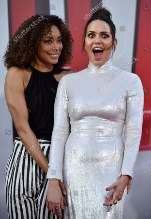 Marta Milans (R) and Gina Torres attend the world premiere of 'Shazam!' at the TCL Chinese Theatre in Los Angeles, California on March 28, 2019.