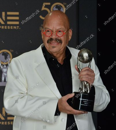 Stock Picture of Tom Joyner, Vanguard Award Recipient, appears backstage with his award during the 50th annual NAACP Image Awards at Loews Hollywood Hotel in the Hollywood section of Los Angeles on March 30, 2019. The NAACP Image Awards celebrates the accomplishments of people of color in the fields of television, music, literature and film and also honors individuals or groups who promote social justice through creative endeavors.
