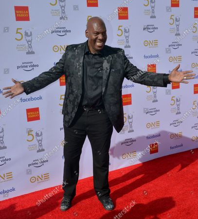 Stock Photo of Ben Tankard arrives for the 50th annual NAACP Image Awards at the Dolby Theatre in the Hollywood section of Los Angeles on March 30, 2019. The NAACP Image Awards celebrates the accomplishments of people of color in the fields of television, music, literature and film and also honors individuals or groups who promote social justice through creative endeavors.