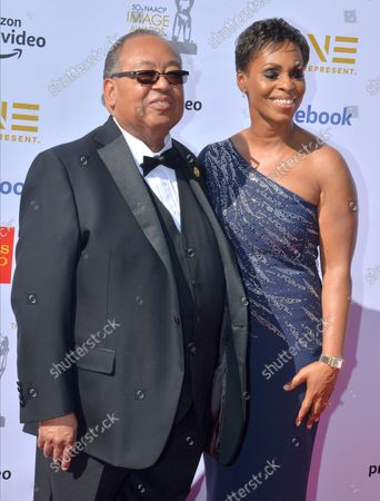 Stock Image of Leon Russell and Karen Towns arrive for the 50th annual NAACP Image Awards at the Dolby Theatre in the Hollywood section of Los Angeles on March 30, 2019. The NAACP Image Awards celebrates the accomplishments of people of color in the fields of television, music, literature and film and also honors individuals or groups who promote social justice through creative endeavors.