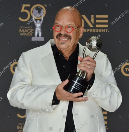 Tom Joyner, Vanguard Award Recipient, appears backstage with his award during the 50th annual NAACP Image Awards at Loews Hollywood Hotel in the Hollywood section of Los Angeles on March 30, 2019. The NAACP Image Awards celebrates the accomplishments of people of color in the fields of television, music, literature and film and also honors individuals or groups who promote social justice through creative endeavors.