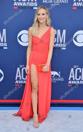 Lauren Bushnell attends the 54th annual Academy of Country Music Awards held at the MGM Grand Garden Arena in Las Vegas, Nevada on April 7, 2019. The show will broadcast live on CBS.