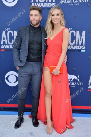 Chris Lane (L) and Lauren Bushnell attend the 54th annual Academy of Country Music Awards held at the MGM Grand Garden Arena in Las Vegas, Nevada on April 7, 2019. The show will broadcast live on CBS.