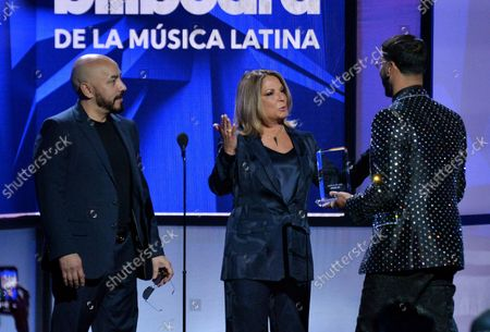 Anuel (R) accepts the New Artist of the Year award from Dra Polo and Lupillo Rivera (R) onstage during the 26th annual Billboard Latin Music Awards at the Mandalay Bay Events Center in Las Vegas, Nevada on April 25, 2019.