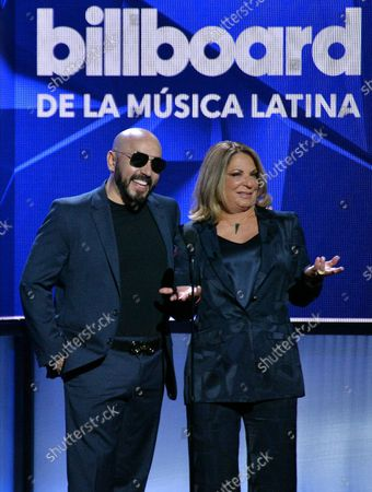 Stock Image of Dra Polo and Lupillo Rivera (R) present an award onstage during the 26th annual Billboard Latin Music Awards at the Mandalay Bay Events Center in Las Vegas, Nevada on April 25, 2019.