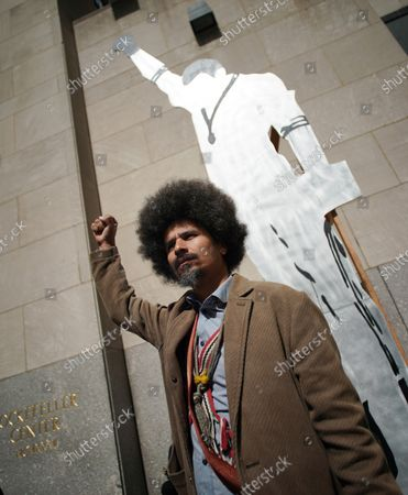 Artist Paulo Nazareth stands with DRY CUT [from BLACKS IN THE POOL - Tommie], 2019 is on display near 6th Avenue at a media preview of the inaugural Frieze Sculpture at Rockefeller Center, a free public art installation featuring 20 sculptures from 14 local and international artists, on April 25, 2019 in New York City. Sculptures from Nick Cave, Aaron Curry, Jose Davila, Walter De Maria, Rochelle Goldberg, Goshka Macuga, Ibrahim Mahama, Joan Miro, Paulo Nazareth, Jaume Plensa, Pedro Reyes, Kiki Smith, Sarah Sze, and Hank Willis Thomas are featured in Frieze Sculpture at Rockefeller Center. Works appear in a variety of indoor and outdoor locations throughout the Center including Rockefeller Plaza, the Channel Gardens, the Rink at Rockefeller Center, North Plaza, and South Esplanade.