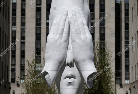 Stock Photo of Jaume Plensa Behind the Walls, 2019 is on display near 5th Avenue at a media preview of the inaugural Frieze Sculpture at Rockefeller Center, a free public art installation featuring 20 sculptures from 14 local and international artists, on April 25, 2019 in New York City. Sculptures from Nick Cave, Aaron Curry, Jose Davila, Walter De Maria, Rochelle Goldberg, Goshka Macuga, Ibrahim Mahama, Joan Miro, Paulo Nazareth, Jaume Plensa, Pedro Reyes, Kiki Smith, Sarah Sze, and Hank Willis Thomas are featured in Frieze Sculpture at Rockefeller Center. Works appear in a variety of indoor and outdoor locations throughout the Center including Rockefeller Plaza, the Channel Gardens, the Rink at Rockefeller Center, North Plaza, and South Esplanade.