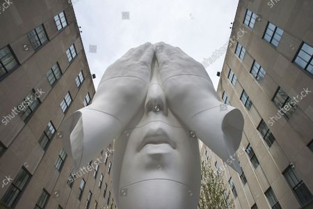 Jaume Plensa Behind the Walls, 2019 is on display near 5th Avenue at a media preview of the inaugural Frieze Sculpture at Rockefeller Center, a free public art installation featuring 20 sculptures from 14 local and international artists, on April 25, 2019 in New York City. Sculptures from Nick Cave, Aaron Curry, Jose Davila, Walter De Maria, Rochelle Goldberg, Goshka Macuga, Ibrahim Mahama, Joan Miro, Paulo Nazareth, Jaume Plensa, Pedro Reyes, Kiki Smith, Sarah Sze, and Hank Willis Thomas are featured in Frieze Sculpture at Rockefeller Center. Works appear in a variety of indoor and outdoor locations throughout the Center including Rockefeller Plaza, the Channel Gardens, the Rink at Rockefeller Center, North Plaza, and South Esplanade.