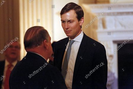 Stock Picture of Senior Advisor to the President Jared Kushner chats with former Governor Mike Huckabee during a dinner on the eve of the National Day of Prayer in the State Dining Room of the White House, in Washington, DC, May 1, 2019.