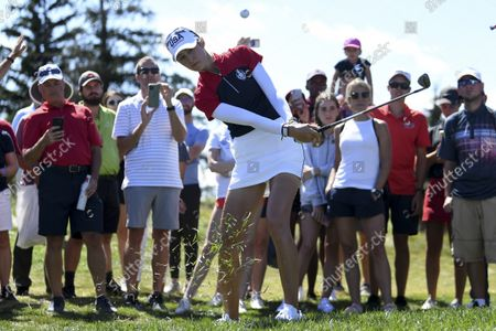 United States' Nelly Korda hits from the rough on the sixth hole during the singles matches at the Solheim Cup golf tournament, in Toledo, Ohio