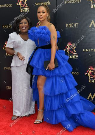 Eve (R) and Sheryl Underwood arrive on the red carpet for the 46th Annual Daytime Emmy Awards at the Pasadena Civic Auditorium in Pasadena, California on May 5, 2019.