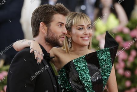 """Miley Cyrus and Liam Hemsworth arrive on the red carpet at The Metropolitan Museum of Art's Costume Institute Benefit """"Camp: Notes on Fashion"""" at Metropolitan Museum of Art in New York City on May 6, 2019."""
