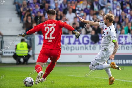Goalkeeper Philipp Kuehn (left) of VfL Osnabrueck and Marcel Risse (right) of FC Viktoria Koeln battle for the ball during the 3. Liga match between VfL Osnabrueck and FC Viktoria Koeln at Bremer Bruecke on September 06, 2021 in Osnabrueck, Germany.