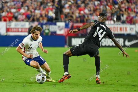 US forward Brenden Aaronson (11), tries to work around Canada midfielder Mark-Anthony Kaye (14), during the World Cup qualifying match between Canada and the USA, at Nissan Stadium in Nashville, TN