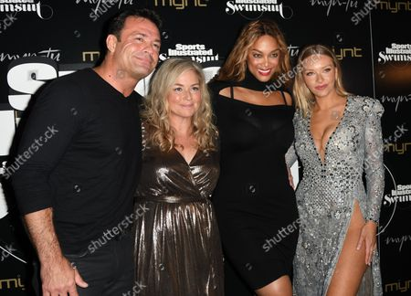 Stock Photo of Romain Zago, MJ Day, Tyra Banks and Camille Kostek walk the red carpet at the  2019 Sports Illustrated Swimsuit magazine party at the Mynt Lounge in Miami Beach, Florida, on May 11,2019.