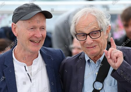 """Paul Laverty (L) and Ken Loach arrive at a photocall for the film """"Sorry We Missed You"""" during the 72nd annual Cannes International Film Festival in Cannes, France on May 17, 2019."""