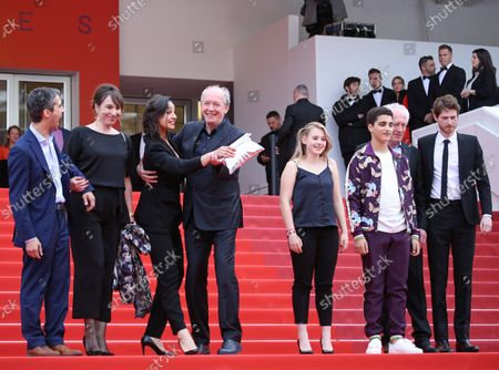 """(From L to R) Othmane Moumen, Carol Duarte, Myriem Akheddiou, Luc Dardenne, Victoria Bluck, Idir Ben Addi, Jean-Pierre Dardenne and Olivier Bonnaud arrive on the red carpet after the screening of the film """"Young Ahmed"""" at the 72nd annual Cannes International Film Festival in Cannes, France on May 20, 2019."""