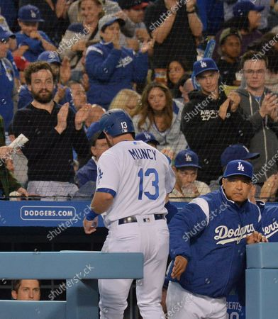 Los Angeles Dodgers' Max Muncy is welcomed back to the dugout after scoreing in the third inning on Enriue Hernandez's RBI single against the Philadelphia Phillies at Dodger Stadium in Los Angeles on June 1, 2019. The Dodgers won 4-3 with a walk-off by rookie Will Smith, his first career home run.