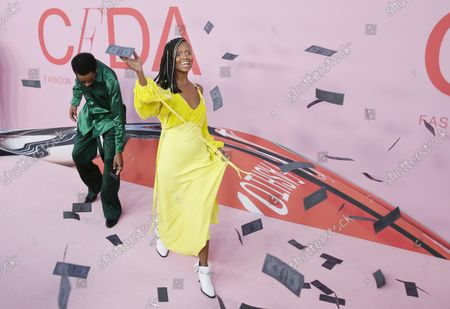 Lakeith Stanfield and Kelela react when Dollar Bliis are tossed in the air on the red carpet at the 2019 CFDA Fashion Awards at the Brooklyn Museum in New York City on June 3, 2019.