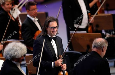 Greek violinist Leonidas Kavakos arrives on the stage to perform Tchaikovsky's Violin Concerto in D major Op.35, accompanied by The Munich Philharmonic orchestra under the baton of Russian conductor Valery Gergiev, on the stage of Grand Palace Hall during Enescu Festival 2021, in Bucharest, Romania, 06 September 2021. The festival, held every two years since 1958, is the biggest classical music festival held in Romania and is named after Romanian composer and violinist George Enescu. The 2021 edition runs from 28 August to 26 September 2021 with the participation of 32 orchestras from 14 countries, totaling 3,500 foreign and Romanian artists. Special measures are being taken to reduce health risks for spectators and artists.