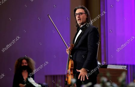 Greek violinist Leonidas Kavakos reacts after performing Tchaikovsky's Violin Concerto in D major Op.35, accompanied by The Munich Philharmonic orchestra under the baton of Russian conductor Valery Gergiev, on the stage of Grand Palace Hall during Enescu Festival 2021, in Bucharest, Romania, 06 September 2021. The festival, held every two years since 1958, is the biggest classical music festival held in Romania and is named after Romanian composer and violinist George Enescu. The 2021 edition runs from 28 August to 26 September 2021 with the participation of 32 orchestras from 14 countries, totaling 3,500 foreign and Romanian artists. Special measures are being taken to reduce health risks for spectators and artists.