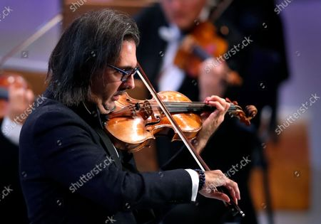 Greek violinist Leonidas Kavakos performs Tchaikovsky's Violin Concerto in D major Op.35, accompanied by The Munich Philharmonic orchestra under the baton of Russian conductor Valery Gergiev, on the stage of Grand Palace Hall during Enescu Festival 2021, in Bucharest, Romania, 06 September 2021. The festival, held every two years since 1958, is the biggest classical music festival held in Romania and is named after Romanian composer and violinist George Enescu. The 2021 edition runs from 28 August to 26 September 2021 with the participation of 32 orchestras from 14 countries, totaling 3,500 foreign and Romanian artists. Special measures are being taken to reduce health risks for spectators and artists.