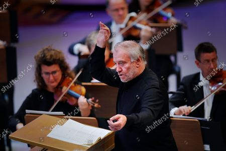 Stock Photo of Russian conductor Valery Gergiev performs, with The Munich Philharmonic orchestra, Bruckner's Symphony No. 6 in A major WAB 106 on the stage of Grand Palace Hall during Enescu Festival 2021, in Bucharest, Romania, 06 September 2021. The festival, held every two years since 1958, is the biggest classical music festival held in Romania and is named after Romanian composer and violinist George Enescu. The 2021 edition runs from 28 August to 26 September 2021 with the participation of 32 orchestras from 14 countries, totaling 3,500 foreign and Romanian artists. Special measures are being taken to reduce health risks for spectators and artists.