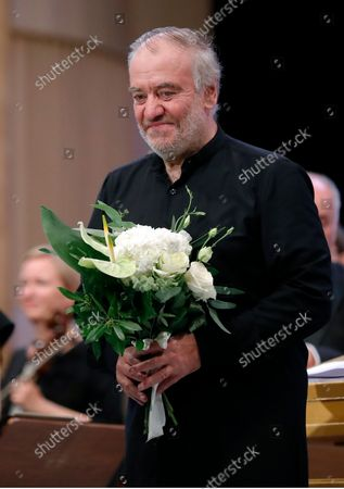 Russian conductor Valery Gergiev reacts while holding a bunch of flowers after performing, with The Munich Philharmonic orchestra, Bruckner's Symphony No. 6 in A major WAB 106 on the stage of Grand Palace Hall during Enescu Festival 2021, in Bucharest, Romania, 06 September 2021. The festival, held every two years since 1958, is the biggest classical music festival held in Romania and is named after Romanian composer and violinist George Enescu. The 2021 edition runs from 28 August to 26 September 2021 with the participation of 32 orchestras from 14 countries, totaling 3,500 foreign and Romanian artists. Special measures are being taken to reduce health risks for spectators and artists.