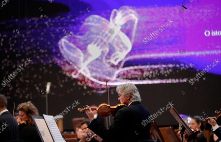 Members of The Munich Philharmonic orchestra perform Bruckner's Symphony No. 6 in A major WAB 106, under the baton of Russian conductor Valery Gergiev (not pictured), on the stage of Grand Palace Hall during Enescu Festival 2021, in Bucharest, Romania, 06 September 2021. The festival, held every two years since 1958, is the biggest classical music festival held in Romania and is named after Romanian composer and violinist George Enescu. The 2021 edition runs from 28 August to 26 September 2021 with the participation of 32 orchestras from 14 countries, totaling 3,500 foreign and Romanian artists. Special measures are being taken to reduce health risks for spectators and artists.