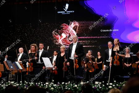 Members of The Munich Philharmonic orchestra react after performing Bruckner's Symphony No. 6 in A major WAB 106, under the baton of Russian conductor Valery Gergiev (not pictured), on the stage of Grand Palace Hall during Enescu Festival 2021, in Bucharest, Romania, 06 September 2021. The festival, held every two years since 1958, is the biggest classical music festival held in Romania and is named after Romanian composer and violinist George Enescu. The 2021 edition runs from 28 August to 26 September 2021 with the participation of 32 orchestras from 14 countries, totaling 3,500 foreign and Romanian artists. Special measures are being taken to reduce health risks for spectators and artists.