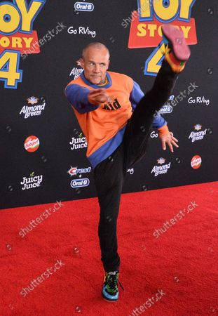 """Cast member Flea, the voice of Caboom TV Announcer in the animated motion picture comedy """"Toy Story 4"""" attends the premiere of the film with his wife Jane Hajduk (L) and daughter Elizabeth Allen Dick (C) at the El Capitan Theatre in the Hollywood section of Los Angeles on June 11, 2019. Storyline: Woody, Buzz Lightyear and the rest of the gang embark on a road trip with Bonnie and a new toy named Forky. The adventurous journey turns into an unexpected reunion as Woody's slight detour leads him to his long-lost friend Bo Peep. As Woody and Bo discuss the old days, they soon start to realize that they're two worlds apart when it comes to what they want from life as a toy."""