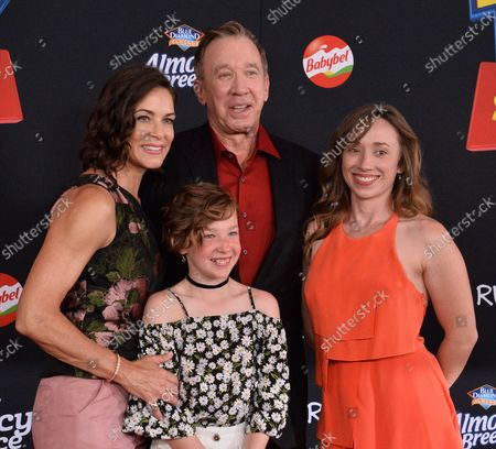 """Stock Photo of Cast member Tim Allen, the voice of Buzz Lightyear in the animated motion picture comedy """"Toy Story 4"""" attends the premiere of the film with his wife Jane Hajduk (L) and daughter Elizabeth Allen Dick (C) at the El Capitan Theatre in the Hollywood section of Los Angeles on June 11, 2019. Storyline: Woody, Buzz Lightyear and the rest of the gang embark on a road trip with Bonnie and a new toy named Forky. The adventurous journey turns into an unexpected reunion as Woody's slight detour leads him to his long-lost friend Bo Peep. As Woody and Bo discuss the old days, they soon start to realize that they're two worlds apart when it comes to what they want from life as a toy."""