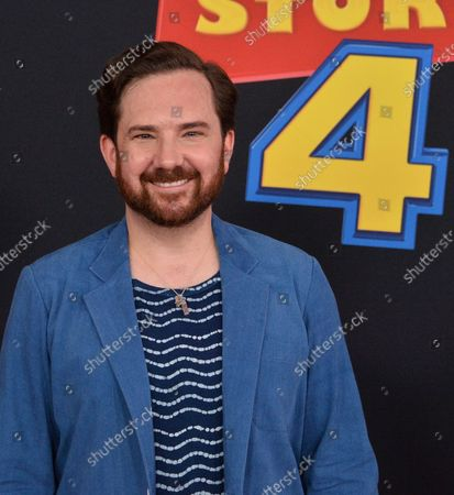 """Cast member John Morris, the voice of Teenage Andy in the animated motion picture comedy """"Toy Story 4"""" attends the premiere of the film with his wife Jane Hajduk (L) and daughter Elizabeth Allen Dick (C) at the El Capitan Theatre in the Hollywood section of Los Angeles on June 11, 2019. Storyline: Woody, Buzz Lightyear and the rest of the gang embark on a road trip with Bonnie and a new toy named Forky. The adventurous journey turns into an unexpected reunion as Woody's slight detour leads him to his long-lost friend Bo Peep. As Woody and Bo discuss the old days, they soon start to realize that they're two worlds apart when it comes to what they want from life as a toy."""