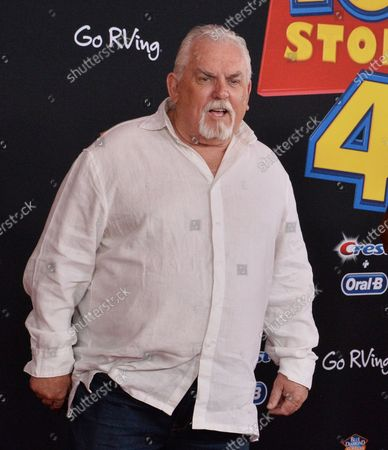 """Cast member John Ratzenberger, the voice of Hamm in the animated motion picture comedy """"Toy Story 4"""" attends the premiere of the film at the El Capitan Theatre in the Hollywood section of Los Angeles on June 11, 2019. Storyline: Woody, Buzz Lightyear and the rest of the gang embark on a road trip with Bonnie and a new toy named Forky. The adventurous journey turns into an unexpected reunion as Woody's slight detour leads him to his long-lost friend Bo Peep. As Woody and Bo discuss the old days, they soon start to realize that they're two worlds apart when it comes to what they want from life as a toy."""