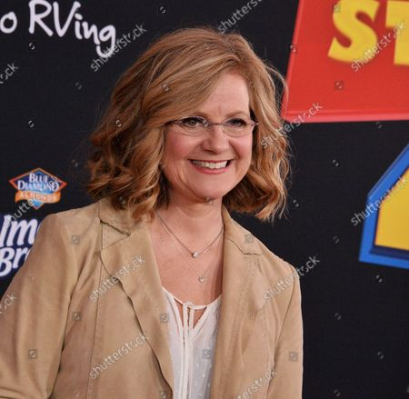 """Cast member Bonnie Hunt, the voice of Dolly in the animated motion picture comedy """"Toy Story 4"""" attends the premiere of the film with his wife Jane Hajduk (L) and daughter Elizabeth Allen Dick (C) at the El Capitan Theatre in the Hollywood section of Los Angeles on June 11, 2019. Storyline: Woody, Buzz Lightyear and the rest of the gang embark on a road trip with Bonnie and a new toy named Forky. The adventurous journey turns into an unexpected reunion as Woody's slight detour leads him to his long-lost friend Bo Peep. As Woody and Bo discuss the old days, they soon start to realize that they're two worlds apart when it comes to what they want from life as a toy."""