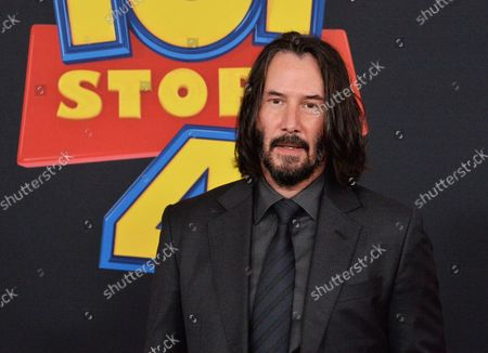 """Stock Picture of Cast member Keanu Reeves, the voice of Duke Caboom in the animated motion picture comedy """"Toy Story 4"""" attends the premiere of the film with his wife Jane Hajduk (L) and daughter Elizabeth Allen Dick (C) at the El Capitan Theatre in the Hollywood section of Los Angeles on June 11, 2019. Storyline: Woody, Buzz Lightyear and the rest of the gang embark on a road trip with Bonnie and a new toy named Forky. The adventurous journey turns into an unexpected reunion as Woody's slight detour leads him to his long-lost friend Bo Peep. As Woody and Bo discuss the old days, they soon start to realize that they're two worlds apart when it comes to what they want from life as a toy."""