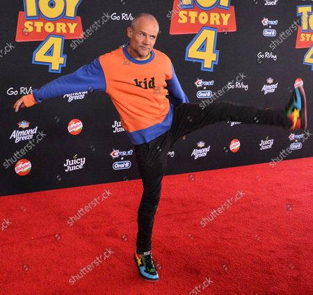 """Stock Image of Cast member Flea, the voice of Caboom TV Announcer in the animated motion picture comedy """"Toy Story 4"""" attends the premiere of the film with his wife Jane Hajduk (L) and daughter Elizabeth Allen Dick (C) at the El Capitan Theatre in the Hollywood section of Los Angeles on June 11, 2019. Storyline: Woody, Buzz Lightyear and the rest of the gang embark on a road trip with Bonnie and a new toy named Forky. The adventurous journey turns into an unexpected reunion as Woody's slight detour leads him to his long-lost friend Bo Peep. As Woody and Bo discuss the old days, they soon start to realize that they're two worlds apart when it comes to what they want from life as a toy."""