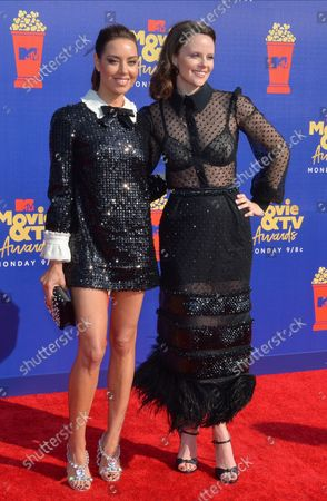 Stock Photo of (L-R) Aubrey Plaza and Sarah Ramos arrive for the taping of the 28th annual MTV Movie & TV Awards ceremony at the Barker Hangar in Santa Monica, California on June 15, 2019. The show will air on Monday, June 17th.
