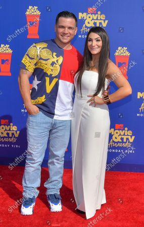 Christopher Buckner and Deena Nicole Cortese arrive for the taping of the 28th annual MTV Movie & TV Awards ceremony at the Barker Hangar in Santa Monica, California on June 15, 2019. The show will air on Monday, June 17th.