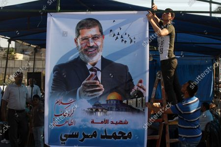 Editorial picture of Palestinians sit in a Mourning Tent for Former Egyptian President Mohamed Mursi, Khan Younis, Gaza - 19 Jun 2019