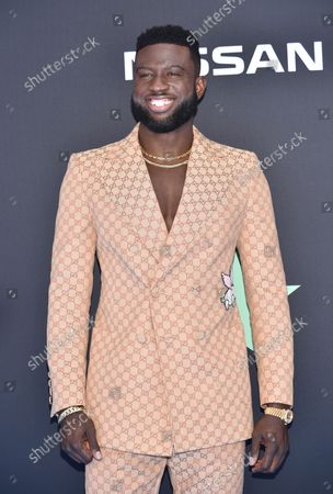 Sinqua Walls arrives for the 19th annual BET Awards at the Microsoft Theater in Los Angeles on June 23, 2019. The BET Awards were established in 2001 by the Black Entertainment Television network to celebrate African Americans and other American minorities in entertainment, culture and sports over the past year. The show will air live on BET beginning at 8 p.m. EST.