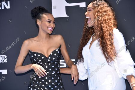 Lyric Anderson and Tami Roman (R) arrive for the 19th annual BET Awards at the Microsoft Theater in Los Angeles on June 23, 2019. The BET Awards were established in 2001 by the Black Entertainment Television network to celebrate African Americans and other American minorities in entertainment, culture and sports over the past year. The show will air live on BET beginning at 8 p.m. EST.
