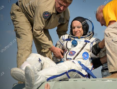 Stock Image of Expedition 59 astronaut David Saint-Jacques of the Canadian Space Agency (CSA) is helped out of the Soyuz MS-11 spacecraft just minutes after he, NASA astronaut Anne McClain, and Roscosmos cosmonaut Oleg Kononenko, landed in a remote area near the town of Zhezkazgan, Kazakhstan on June 25, 2019, Kazakh time (June 24 Eastern time). McClain, Saint-Jacques, and Kononenko are returning after 204 days in space where they served as members of the Expedition 58 and 59 crews onboard the International Space Station. NASA