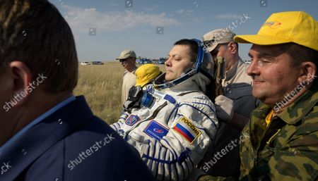 Stock Photo of Expedition 59 cosmonaut Oleg Kononenko of Roscosmos is carried to a medical tent shortly after he, NASA astronaut Anne McClain, and Canadian Space Agency astronaut David Saint-Jacques landed in their Soyuz MS-11 spacecraft near the town of Zhezkazgan, Kazakhstan on June 25, 2019, Kazakh time (June 24 Eastern time). McClain, Saint-Jacques, and Kononenko are returning after 204 days in space where they served as members of the Expedition 58 and 59 crews onboard the International Space Station. NASA